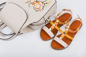 Fashionable Womens Sandals And Backpack On White Background poster