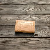 Brown Leather Elegance Womens Wallet On Dark Wooden Background. For Instagram Format. Square. poster