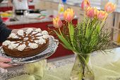 Simple Low Calorie Pie With A Bouquet Of Tulips Served - Detail poster