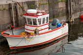 foto of outboard  - mini size fish trawler with outboard motor - JPG