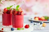 Berry flavored mousse topped with fresh berries in glasses. Summer dessert with strawberry,raspberry poster
