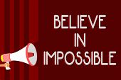 Handwriting Text Believe In Impossible. Concept Meaning You Can Do It Everything Is Possible Work Ha poster