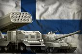 Tank And Rocket Artillery On The Finland Flag Background. Finland Heavy Military Armored Vehicles Co poster
