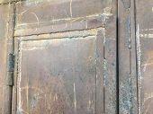 Iron Garage Doors. Rusty Door. Door Hinges. Close Up Shot. poster