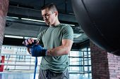 Working Hard. Young Promising Sportsman Working Really Hard In Modern Spacious Gym poster