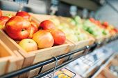 Box with fruits on stand in food store, nobody poster