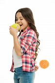 Healthcare Tricks. Kid Girl Cunning Eats Apple While Holds Lollipop Behind Back. Whom She Tries To T poster