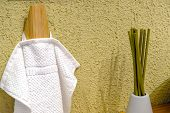 Clean Colored Towels Hanging On The Hanger In The Bathroom. Towels Are Hung On Hooks. poster