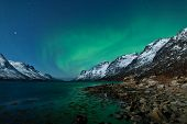 stock photo of north-pole  - A high resolution image of northern lights (Aurora borealis) above fjords and mountains