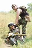 foto of gun shot wound  - Brave soldier drags his wounded partner away from the battlefield - JPG