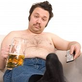stock photo of couch potato  - Overweight man sitting on the couch with a beer glass and remote control - JPG