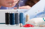picture of thread-making  - reels of colour threads and other sewing accessories like pins - JPG