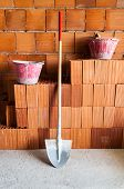 Masonry Bricks, Shovel And Buckets