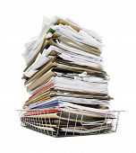stock photo of trays  - office in tray piled high with a large amount of overwhelming work good concept for stress - JPG