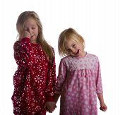 foto of goodnight  - Sleepy sisters in their pajamas and ready for bed - JPG