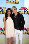 LOS ANGELES - APR 27:  Maia Mitchell, Ross Lynch arrives at the Radio Disney Music Awards 2013 at th