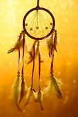 pic of dream-catcher  - Beautiful dream catcher on yellow background with lights - JPG