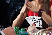foto of poker hand  - Poker game with drinks and cigarettes in casino - JPG