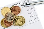 the bank statement and some coins of euro currency