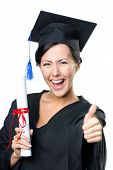 stock photo of school-leaver  - Graduating student with the certificate and in the black academic gown thumbs up - JPG
