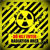stock photo of biological hazard  - detailed illustration of a grungy radiation warning sign - JPG