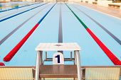 stock photo of swim meet  - Outdoor Swimming Pool with clearly marked lanes - JPG