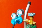 stock photo of air pressure gauge  - The Gauge Hang on the Orange Wall - JPG