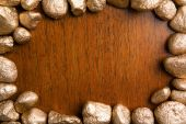 picture of gold nugget  - Wood framed by golden nuggets can be used for background - JPG
