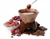 stock photo of cauldron  - Chocolate fondue with fruits - JPG