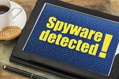 picture of spyware  - spyware  detected alert on a digital tablet with a cup of coffee - JPG