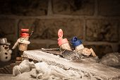 image of midget  - Concept funny sledging with wine cork figures - JPG