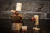 picture of wine-press  - Concept grape juice pressing with wine cork figures - JPG