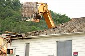 pic of track-hoe  - A large track hoe excavator tearing down an old hotel to make way for a new commercial development - JPG
