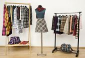 stock photo of tartan plaid  - Colorful dressing closet with plaid clothes and accessories - JPG