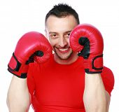 picture of pugilistic  - Portrait of a cheerful sportsman in boxing gloves over white background - JPG