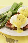 foto of benediction  - Eggs Benedict with hollandaise sauce on hearty multigrain toast with Canadian bacon and asparagus - JPG