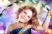 picture of hulahoop  - Portrait of pretty little girl with hulahoop looking at camera - JPG