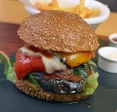 stock photo of veggie burger  - veggie burger with vegetables fries sauce on a plate - JPG