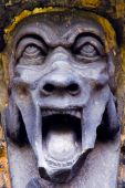 stock photo of gruesome  - A screaming gargoyle on a 17th century  Edinburgh tomb - JPG