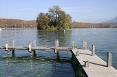 image of pontoon boat  - Wood Pontoon and small island on Annecy Lake France  - JPG