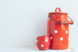 stock photo of milkman  - Set of vintage utensils milk can and small polka dots milkman home kitchen decor in country style painted white background  - JPG