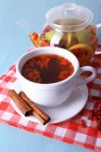 stock photo of chinese checkers  - Goji berries drink in ceramic cup and cinnamon - JPG