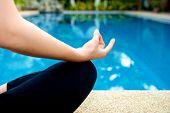 image of padmasana  - Yoga Meditation hand by pool lotus pose  - JPG