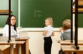 foto of epidemic  - School children are learning in the half empty classroom during epidemic of flu - JPG