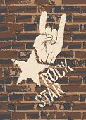 picture of rock star  - Rock Star Sign With Horns Gesture On Brick Wall - JPG