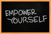 pic of empower  - Business concept of Empower Yourself written with chalk on blackboard - JPG