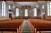 stock photo of church interior  - The interior of a Church viewed from the back - JPG