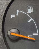 image of fuel economy  - Fuel gauge dash board close up showing empty - JPG