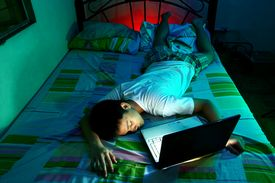 picture of boys night out  - Photo of a Young Teen sleeping in front of a laptop computer and on a bed - JPG