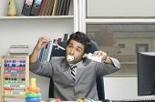 pic of imbecile  - Businessman behaving like a kid in an office - JPG